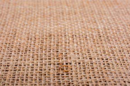 Brown color linen canvas as  background texture