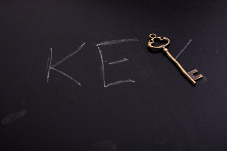 Retro styled golden color key forms the word key