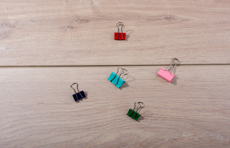 Picture of metallic binder clips with handles in view