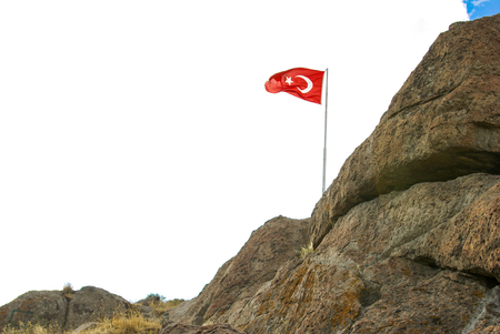 Turkish national flag on a rock in open air