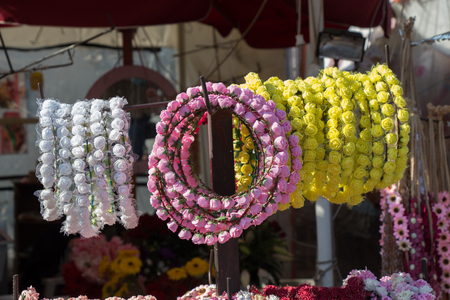 colorful crowns  for sale made of fake flowers