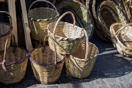 Empty wicker baskets are for sale in a market place