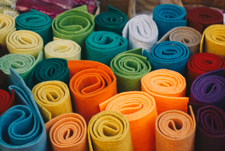 Dozens of colorful fabric rolls in the view