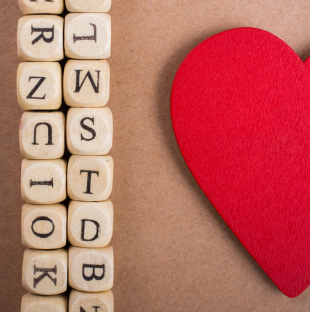 Red Love icon and Letter cubes of made of wood Stock fotó