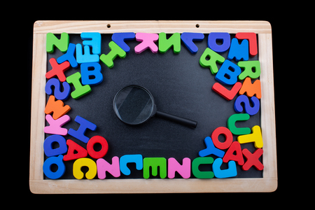 Magnifying glass and Colorful Letters of Alphabet
