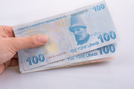 Hand holding 100 Turksh Lira banknotes on white background Stock fotó