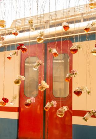 Herbal tea bottles with flowers hanging on strings