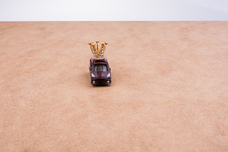 Golden color crown model and a model car