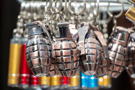 Miniature grenade shaped keychain in the view
