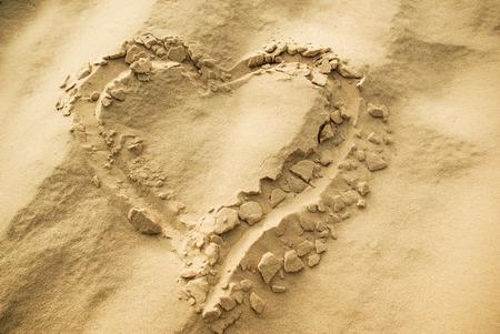 Heart shape drawn on sand
