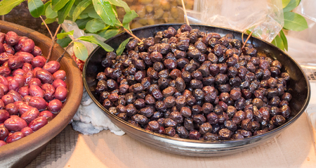 Turkish style prepared olives in the market stands Stok Fotoğraf
