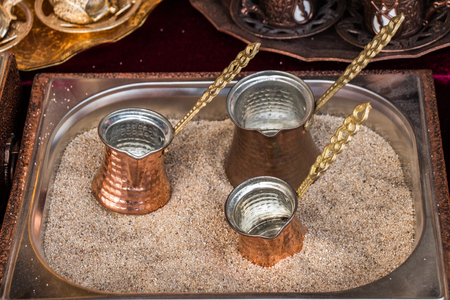 Turkish coffee pots made of metal in a traditional style Imagens