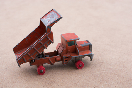 Red Toy car truck on a wooden background