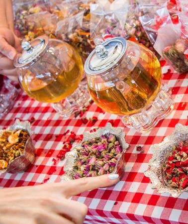 Herbal tea in glass teapot on table Stock Photo