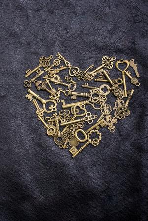 Retro style metal keys form a heart shape on black
