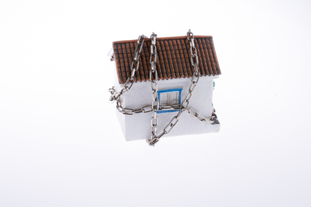 house in chains on a white background