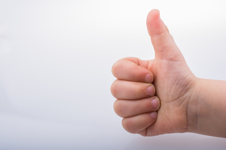 Kid giving  thumb up as a symbol and a like icon 版權商用圖片