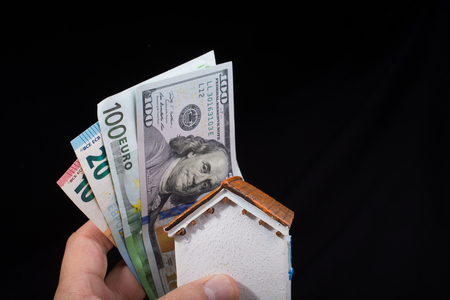 Hand holding American dollar  banknotes isolated on black