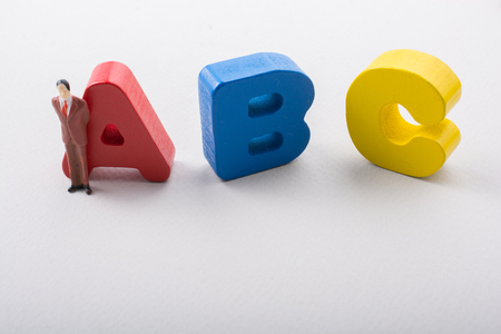 Man figurine and Letters of abc of alphabet on white Stock fotó