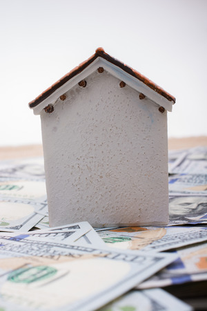 Model house is placed  US dollar Banknotes on spread