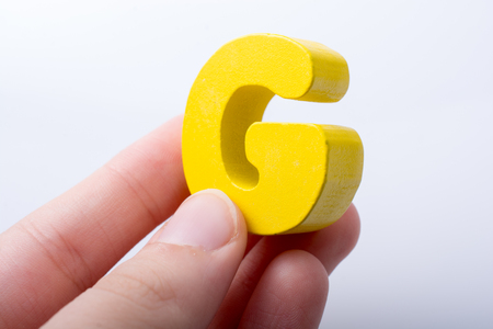 Letter cube of G of  Alphabet made of wood Stock fotó