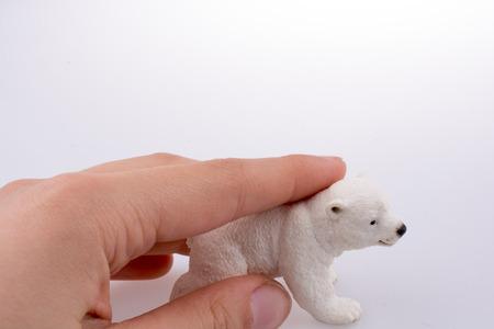 Hand holding White Polar bear model