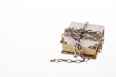 Chained book on white background