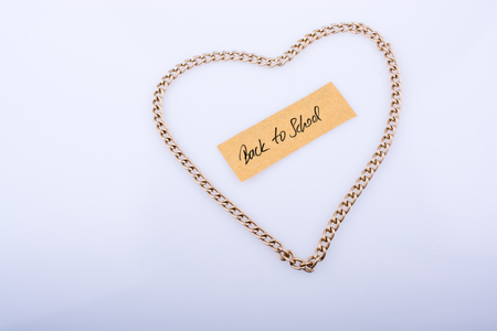Chain forms a heart shape with a title back to school in it