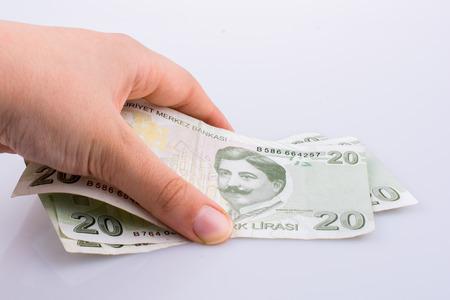 Hand holding 20 Turksh Lira banknote on white background Stock fotó