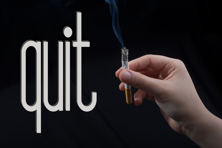 wording QUIT as, say no smoking concept