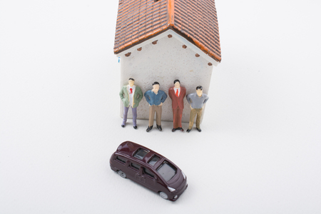 Tiny figurine of man miniature before a house