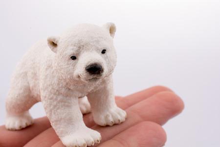 Hand holding White Polar bear model Stock fotó