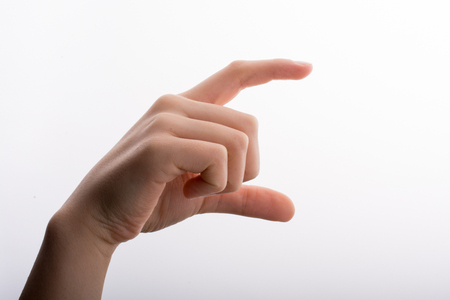 Hand measuring on a white background Standard-Bild