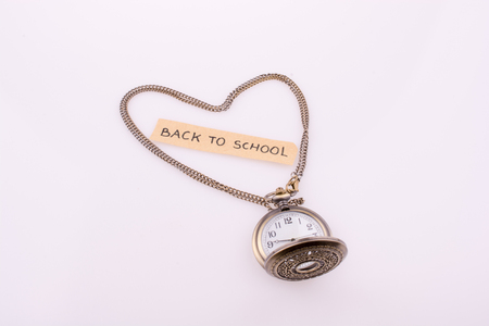 heart shape formed by a pocket watch chain and back to school title Imagens