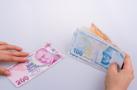 Hand holding Turksh Lira banknotes  on white background Stok Fotoğraf
