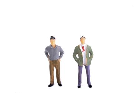 Two figurine model men standing side by side