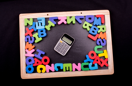 Calculator and Colorful Letters of Alphabet made of wood Stock fotó