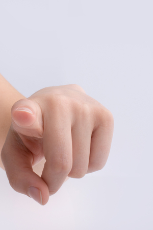 Hand pointing gesture on a white background Imagens