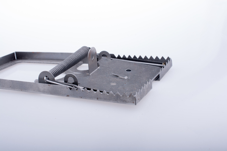 Steel mouse trap in a white background on display