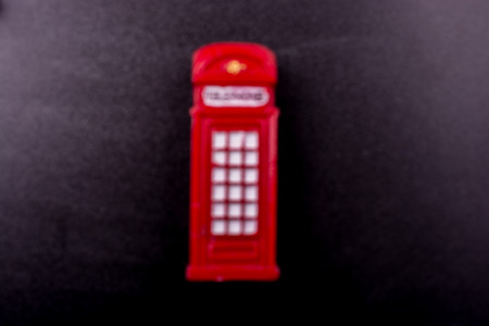 Classical British style Red phone booth of London Фото со стока