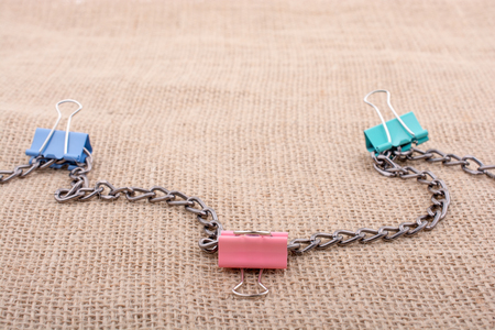 Colorful clips placed on a  linen canvas