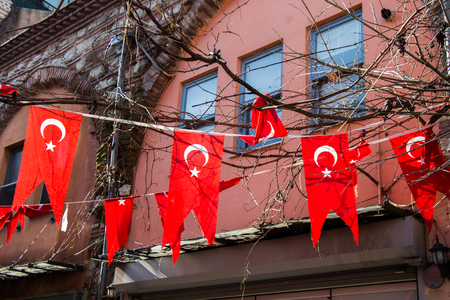 Turkish national flag hanging in the street in open air
