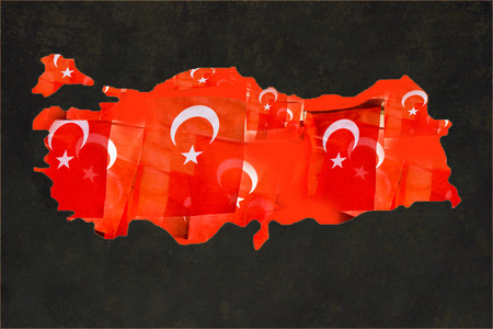 Turkish flags with white star and moon in Turkish map Stock Photo