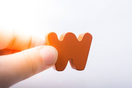 Hand holding letter cube W of made of wood Stock fotó