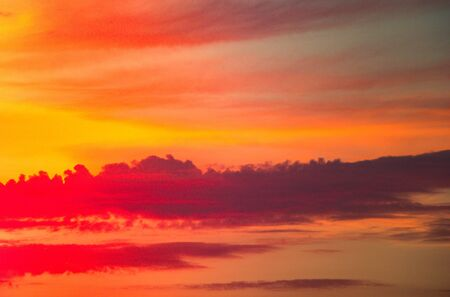 Dramatic colorful  cloudy sky with picturesque clouds lit by sunset