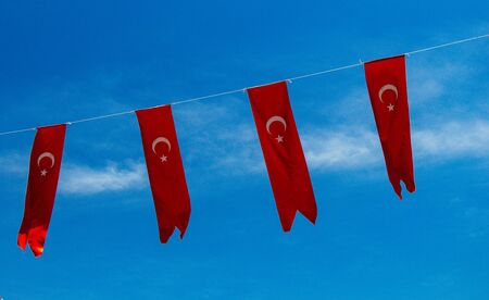 Turkish national flags with white star and moon in sky