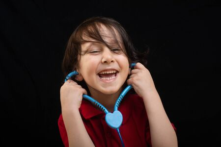 intelligent little boy future doctor holds stethoscope Imagens