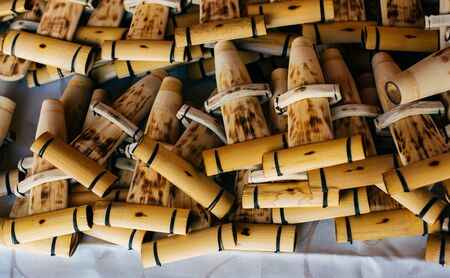 Dozens of handmade bamboo flutes in the view