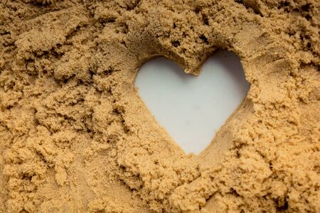 Heart shape made on the sand background in view Reklamní fotografie