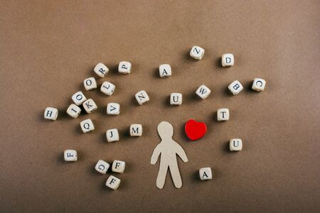 Letter cubes of made of wood  and man figurine and heart shape Reklamní fotografie